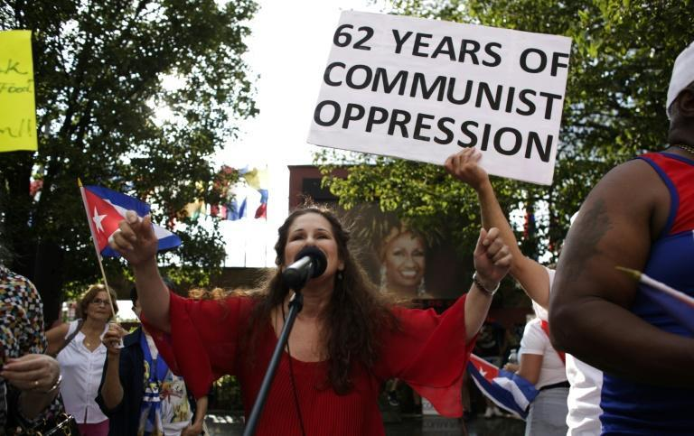 A woman speaks to the crowd during a protest showing support for Cubans demonstrating against their government, in Union City, New Jersey, on July 18, 2021