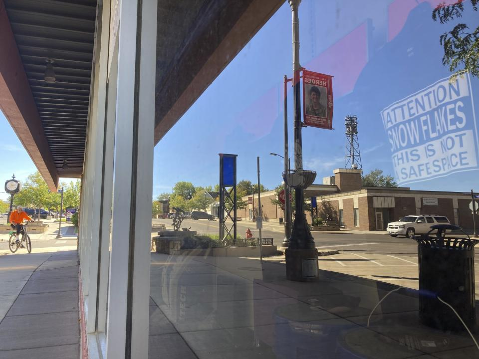 A storefront in downtown Gillette, Wyo., displays a shirt with a political statement on Tuesday, Sept. 21, 2021. Wyoming has the lowest COVID-19 vaccination rate in the U.S. and the Gillette area has one of the lowest rates in Wyoming. (AP Photo/Mead Gruver)