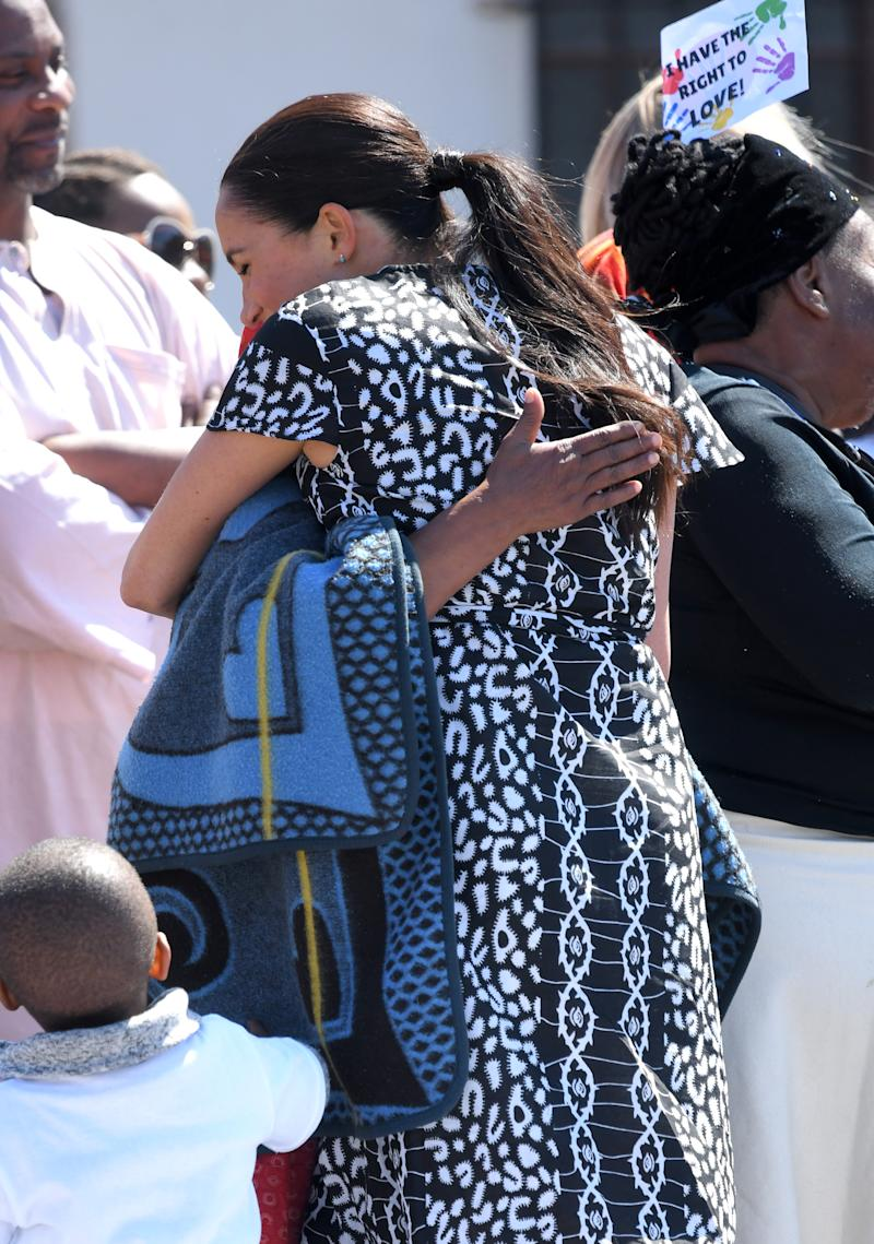 Meghan Markle hugs member of the public in South Africa