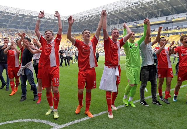 Soccer Football - 2. Bundesliga - Dynamo Dresden v Fortuna Dusseldorf - DDV-Stadion, Dresden, Germany - April 28, 2018 Fortuna Dusseldorf salute their fans as they celebrate after gaining promotion REUTERS/Matthias Rietschel DFL RULES TO LIMIT THE ONLINE USAGE DURING MATCH TIME TO 15 PICTURES PER GAME. IMAGE SEQUENCES TO SIMULATE VIDEO IS NOT ALLOWED AT ANY TIME. FOR FURTHER QUERIES PLEASE CONTACT DFL DIRECTLY AT + 49 69 650050
