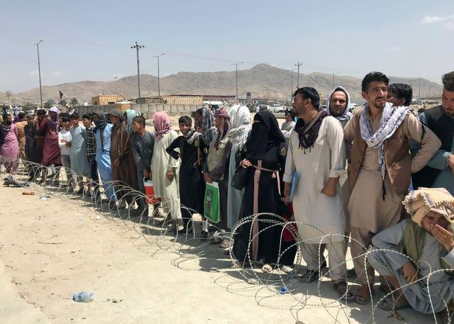 Hundreds of people gather outside the international airport in Kabul, Afghanistan