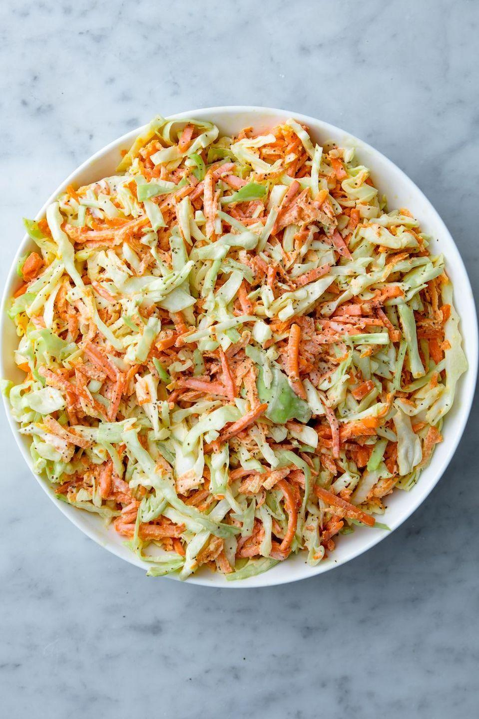 "<p>No summer party is complete without a big bowl of coleslaw, and we happen to think our recipe is the absolute best.</p><p>Get the <a href=""https://www.delish.com/uk/cooking/recipes/a30425814/best-homemade-coleslaw-recipe/"" rel=""nofollow noopener"" target=""_blank"" data-ylk=""slk:Classic Coleslaw"" class=""link rapid-noclick-resp"">Classic Coleslaw</a> recipe.</p>"