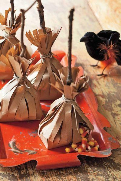 """<p>Stuff recycled paper bags with candy and secure them with twine for a sweet surprise.</p><p><strong><em><a href=""""https://www.womansday.com/home/crafts-projects/how-to/a8649/halloween-decoration-broom-candy-bags-how-to-110915/"""" rel=""""nofollow noopener"""" target=""""_blank"""" data-ylk=""""slk:Get the Broom Candy Bags tutorial"""" class=""""link rapid-noclick-resp"""">Get the Broom Candy Bags tutorial</a>. </em></strong></p><p><a class=""""link rapid-noclick-resp"""" href=""""https://www.amazon.com/AJM-Brown-Paper-Lunch-Count/dp/B003V9MTWY?tag=syn-yahoo-20&ascsubtag=%5Bartid%7C10070.g.2488%5Bsrc%7Cyahoo-us"""" rel=""""nofollow noopener"""" target=""""_blank"""" data-ylk=""""slk:SHOP BROWN PAPER BAGS"""">SHOP BROWN PAPER BAGS</a></p>"""
