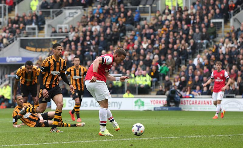 Arsenal's Lukas Podolski scores his side's third goal during their English Premier League soccer match against Hull City at The KC Stadium, Hull, England, Sunday, April 20, 2014. (AP Photo/Lynne Cameron, PA Wire) UNITED KINGDOM OUT - NO SALES - NO ARCHIVES