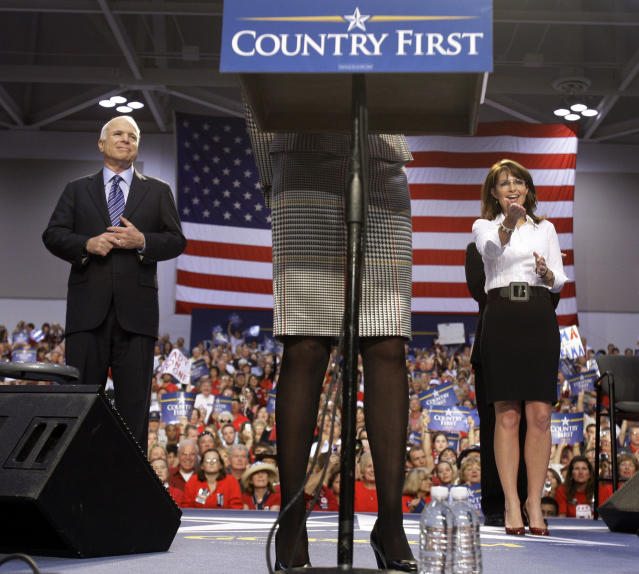 <p>Republican presidential candidate Sen. John McCain and his vice presidential running mate, Alaska Gov. Sarah Palin, stand onstage as Cindy McCain, center, introduces Palin at a rally at the Virginia Beach Convention Center in Virginia Beach, Va., Oct. 13, 2008. (Photo: Carolyn Kaster/AP) </p>