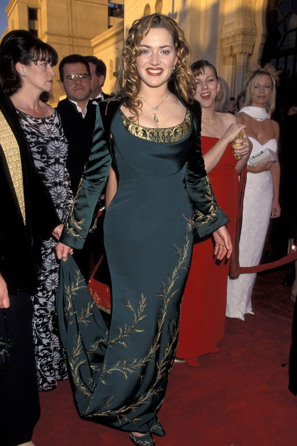<p>The deep-green color and gold embroidery on the Givenchy gown Kate Winslet wore to the 1998 Oscars is so strikingly similar to Merida's that we have to wonder if Disney used it as inspiration for its 2012 movie.</p>
