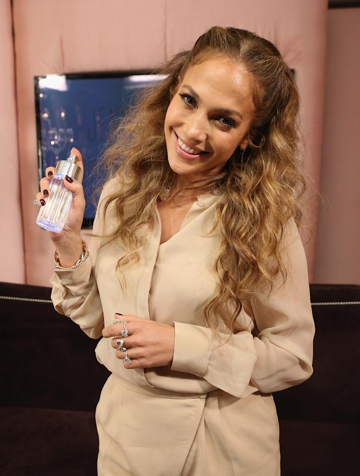 """<p>J Lo kickstarted the celebrity fragrance trend in 2004 with Glow. In its first year, the scent <a rel=""""nofollow"""" href=""""http://www.dailymail.co.uk/femail/article-2166625/Jennifer-Lopezs-perfume-sells-celebrity-fragrance.html"""">made £225 million</a> thanks to its star status and notes of orange, jasmine and grapefruit. 13 years later and Jennifer has capitalised on her success, launching over 20 perfumes, netting almost £1.5 billion.<br /><i>[Photo: Getty]</i> </p>"""