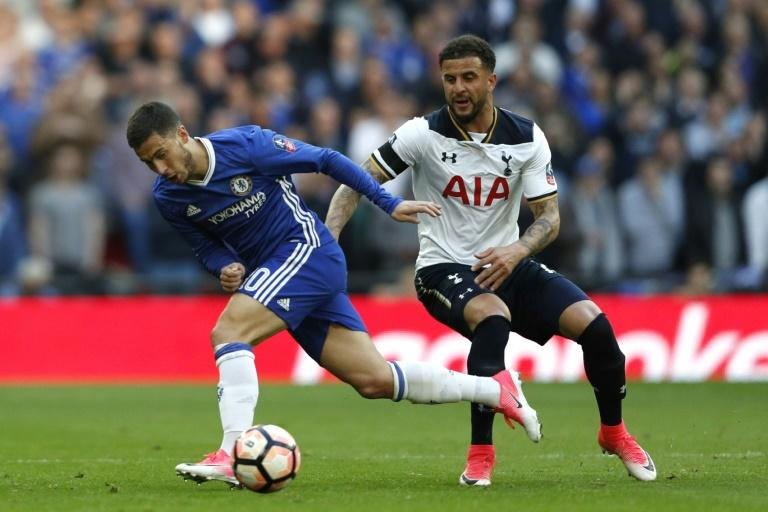 Chelsea's Eden Hazard (L) fights for the ball with Tottenham Hotspur's Kyle Walker during their FA Cup semi-final match, at Wembley stadium in London, on April 22, 2017