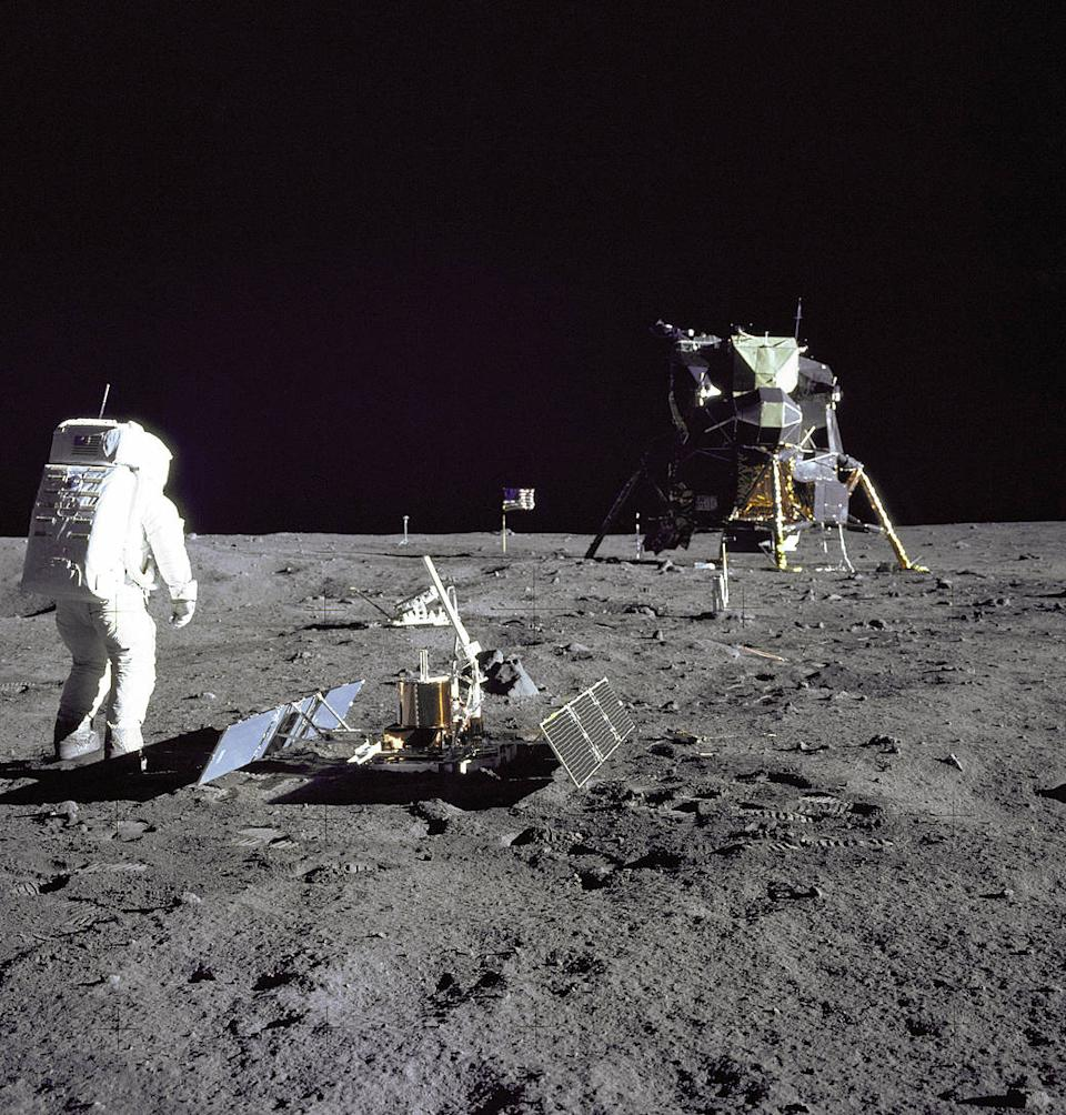 """On July 20, 1969, America's Apollo 11 landed on the moon, making history as the first humans set foot on another world. Lunar Module pilot Buzz Aldrin was photographed during the Apollo 11 extravehicular activity on the moon by mission commander Neil Armstrong. Aldrin had just deployed the Early Apollo Scientific Experiments Package. In the foreground is the Passive Seismic Experiment Package; beyond it is the Laser Ranging Retro-Reflector (LR-3); in the far right background is the Lunar Module """"Eagle."""" (Photo: NASA)"""