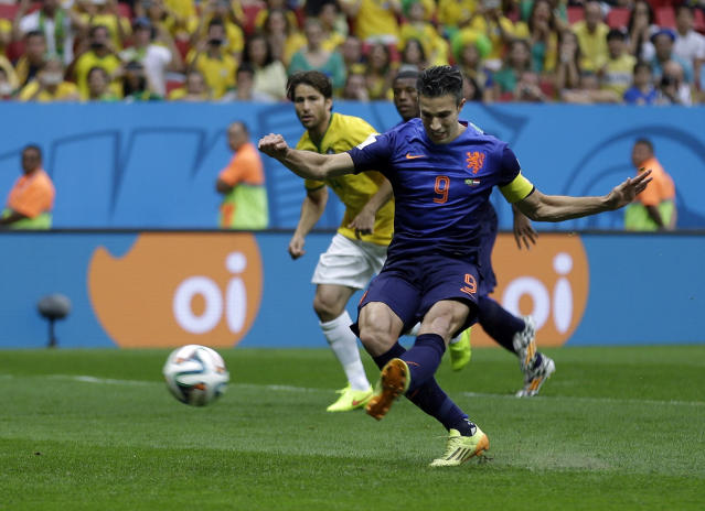 Netherlands' Robin van Persie shoots to score his team's first goal on a penalty shot during the World Cup third-place soccer match between Brazil and the Netherlands at the Estadio Nacional in Brasilia, Brazil, Saturday, July 12, 2014. (AP Photo/Natacha Pisarenko)