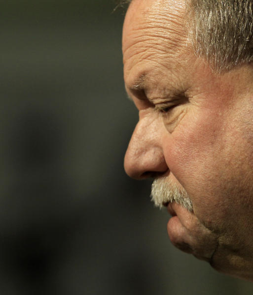 Former Cleveland Browns president Mike Holmgren pauses as he answers questions during a news conference Monday, Nov. 26, 2012, in Berea, Ohio. Holmgren is leaving the team immediately rather than stay on as an adviser through the end of this season. His exit raises more questions about a possible return to coaching and what he truly accomplished during his time with Cleveland. (AP Photo/Tony Dejak)