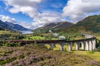 """<p>An off-shoot of the West Highland line, this section is world-famous for the stunning Glenfinnan Viaduct, which the Hogwarts Express soars over in the Harry Potter films. </p><p>Undoubtedly the best way to travel this route is, like Harry, by classic steam train. </p><p>The iconic Jacobite, or the <a href=""""https://www.goodhousekeeping.com/uk/lifestyle/travel/a33642336/harry-potter-train-scotland/"""" rel=""""nofollow noopener"""" target=""""_blank"""" data-ylk=""""slk:Harry Potter train"""" class=""""link rapid-noclick-resp"""">Harry Potter train</a>, as it's known to many, offers the perfect way to travel through the Highland scenery, occasionally pausing on the 21-arched viaduct, allowing you time to take in breathtaking views of the mountainous, mossy terrain and glistening Loch Shiel in the distance.</p><p>Good Housekeeping is taking a trip on the Jacobite steam locomotive with Scottish weather presenter <a href=""""https://www.goodhousekeepingholidays.com/tours/scotland-rail-steam-tour-carol-kirkwood"""" rel=""""nofollow noopener"""" target=""""_blank"""" data-ylk=""""slk:Carol Kirkwood"""" class=""""link rapid-noclick-resp"""">Carol Kirkwood</a> in autumn 2021.</p><p>We'll start near Britain's highest mountain, Ben Nevis, and pass by Loch Morar, where Carol herself grew up, and over the iconic Viaduct to Loch Nevis. </p><p>There's also a chance to experience the Falkirk boat lift, cruise on bonnie Loch Katrine and Voyage on the historic PS Waverley in 2022.</p><p><a class=""""link rapid-noclick-resp"""" href=""""https://www.goodhousekeepingholidays.com/tours/scotland-highlands-steam-train-jacobite"""" rel=""""nofollow noopener"""" target=""""_blank"""" data-ylk=""""slk:FIND OUT MORE"""">FIND OUT MORE</a></p>"""