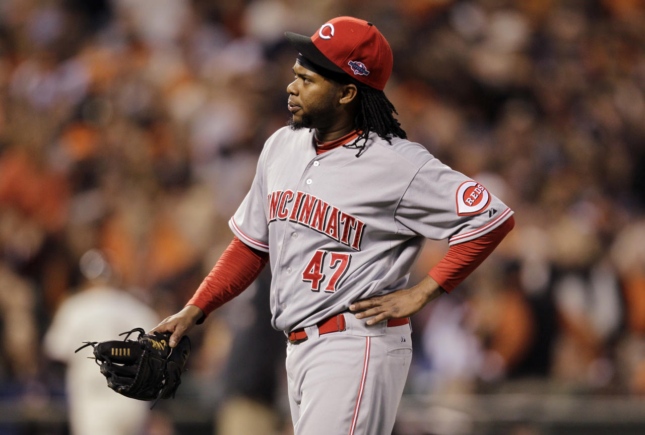 Cincinnati Reds starting pitcher Johnny Cueto heads to the dugout after pitching in the first inning of Game 1 of the National League division baseball series against the San Francisco Giants in San Francisco, Saturday, Oct. 6, 2012. Cueto left the game with an injury. (AP Photo/Eric Risberg)