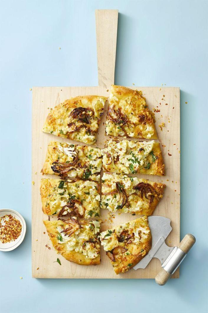 """<p>Who decided pizza can't be healthy?! You'll only need five ingredients to throw this together in 40 minutes, and since each quarter is just over 300 calories, you can even reach for another slice.</p><p><a href=""""https://www.goodhousekeeping.com/food-recipes/easy/a25657281/roasted-cauliflower-pizza-recipe/"""" rel=""""nofollow noopener"""" target=""""_blank"""" data-ylk=""""slk:Get the recipe for Roasted Cauliflower Pizza »"""" class=""""link rapid-noclick-resp""""><em>Get the recipe for Roasted Cauliflower Pizza »</em></a></p>"""