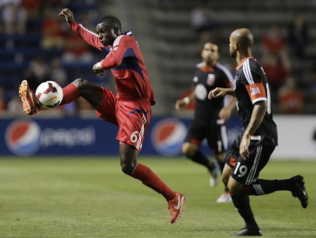 Chicago Fire defender Jalil Anibaba, left, controls the ball against D.C. United midfielder Kyle Porter during the second half of the Lamar Hunt U.S. Open Cup semifinal soccer match on Wednesday, Aug. 7, 2013, in Bridgeview, Ill. D.C. United won 2-0. (AP Photo/Nam Y. Huh)