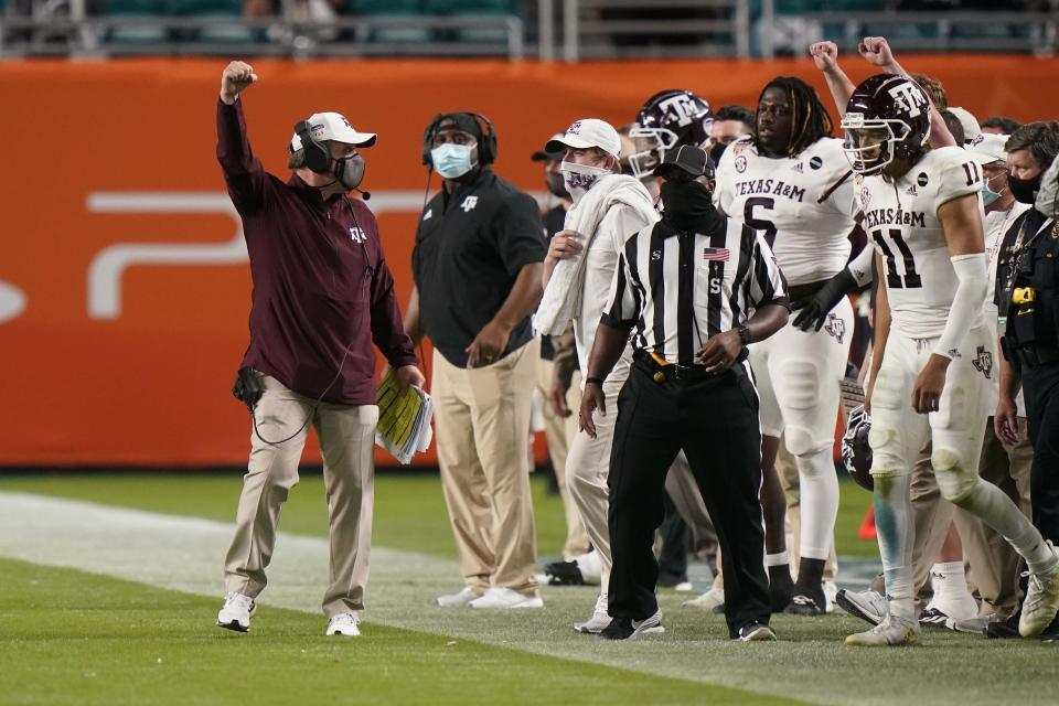 Texas A&M head coach Jimbo Fisher gestures during the second half of the Orange Bowl NCAA college football game against North Carolina, Saturday, Jan. 2, 2021, in Miami Gardens, Fla. (AP Photo/Lynne Sladky)