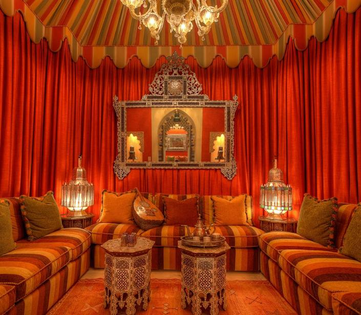 <p>Who needs windows when you have red silk wall coverings and mirrors reflecting the splendors of Morocco? (Photo by Steve Brown/Sepia Productions)</p>