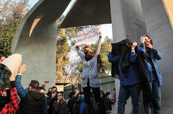 Iranian students protest at the University of Tehran during a demonstration driven by anger over economic problems, in the capital Tehran on December 30, 2017. Students protested in a third day of demonstrations, videos on social media showed, but were outnumbered by counter-demonstrators.(Photo credit STR/AFP/Getty Images)