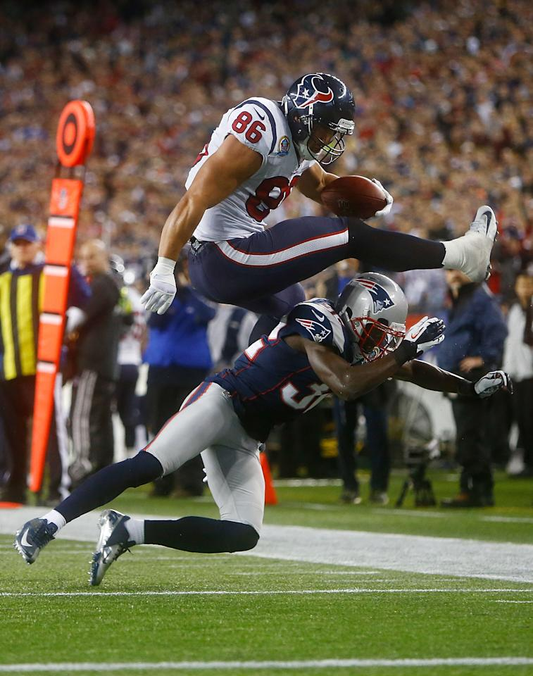 FOXBORO, MA - DECEMBER 10: James Casey #86 of the Houston Texans attempts to hurdle Devin McCourty #32 of the New England Patriots after catching a pass during the game at Gillette Stadium on December 10, 2012 in Foxboro, Massachusetts. (Photo by Jared Wickerham/Getty Images)