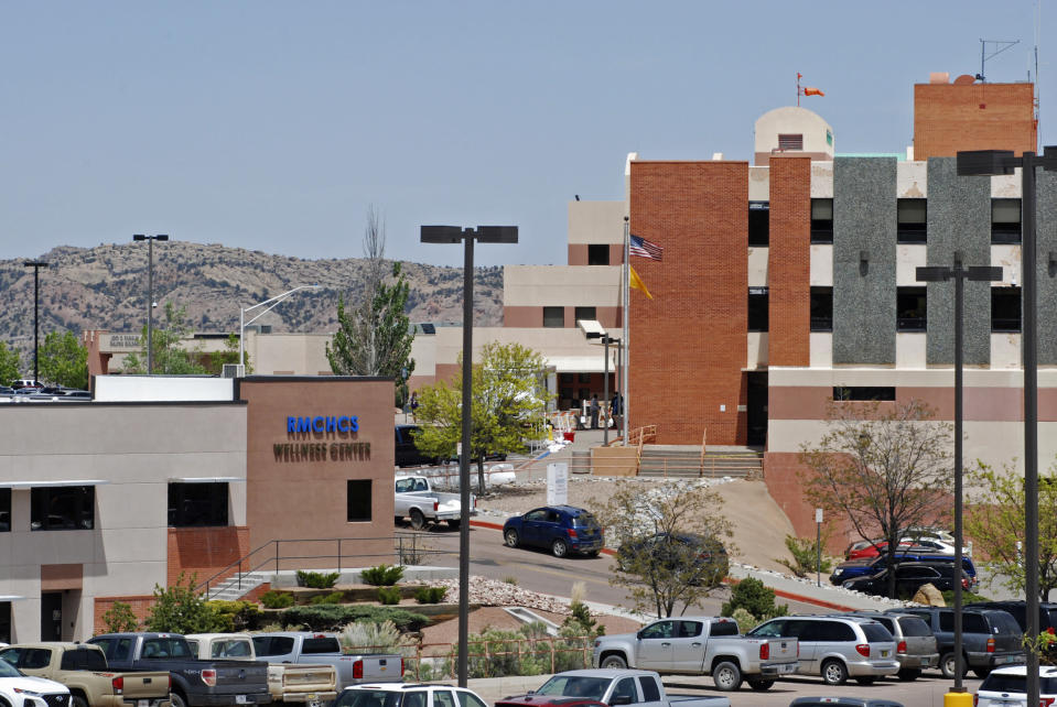 This May 8, 2020, photo shows Rehoboth McKinley Christian Hospital in Gallup, N.M. Of about 500 medical and support staff, at least 32 hospital workers have become infected, and doctors and nurses say that they all live with the fear of spreading the virus to their colleagues and relatives. (AP Photo/Morgan Lee)