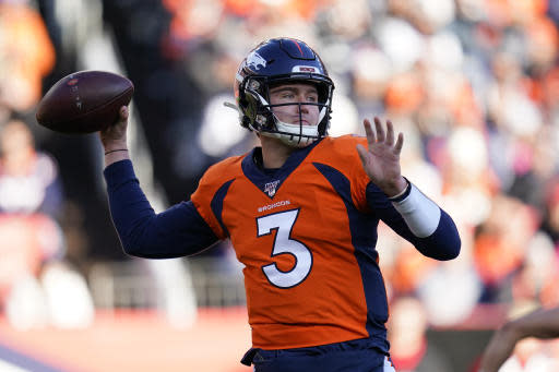 """FILE - In this Dec. 29, 2019, file photo, Denver Broncos quarterback Drew Lock throws a pass during the first half of an NFL football game against the Oakland Raiders in Denver. John Elway says expectations for Lock this season are """"definitely tempered"""" by the effects of the coronavirus that scuttled the regular offseason and all preseason games(AP Photo/Jack Dempsey, File)"""