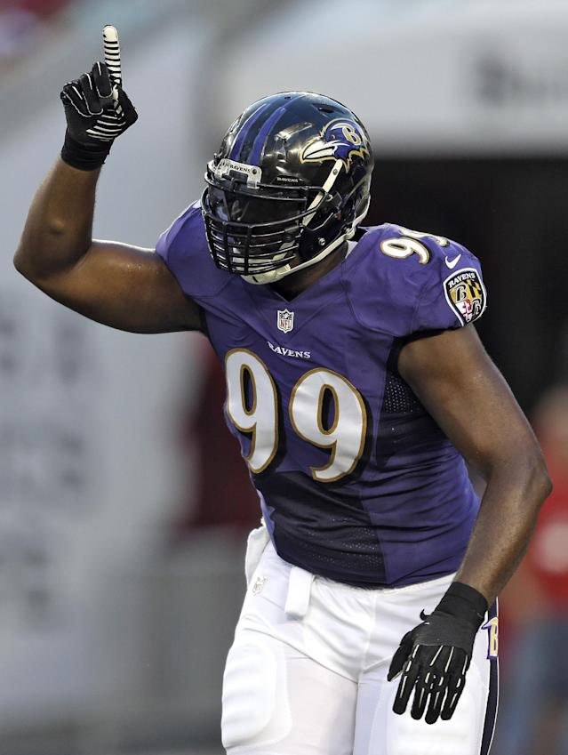 Baltimore Ravens defensive tackle Chris Canty celebrates after sacking Tampa Bay Buccaneers quarterback Josh Freeman during the first quarter of an NFL preseason football game Thursday, Aug. 8, 2013, in Tampa, Fla. (AP Photo/Chris O'Meara)