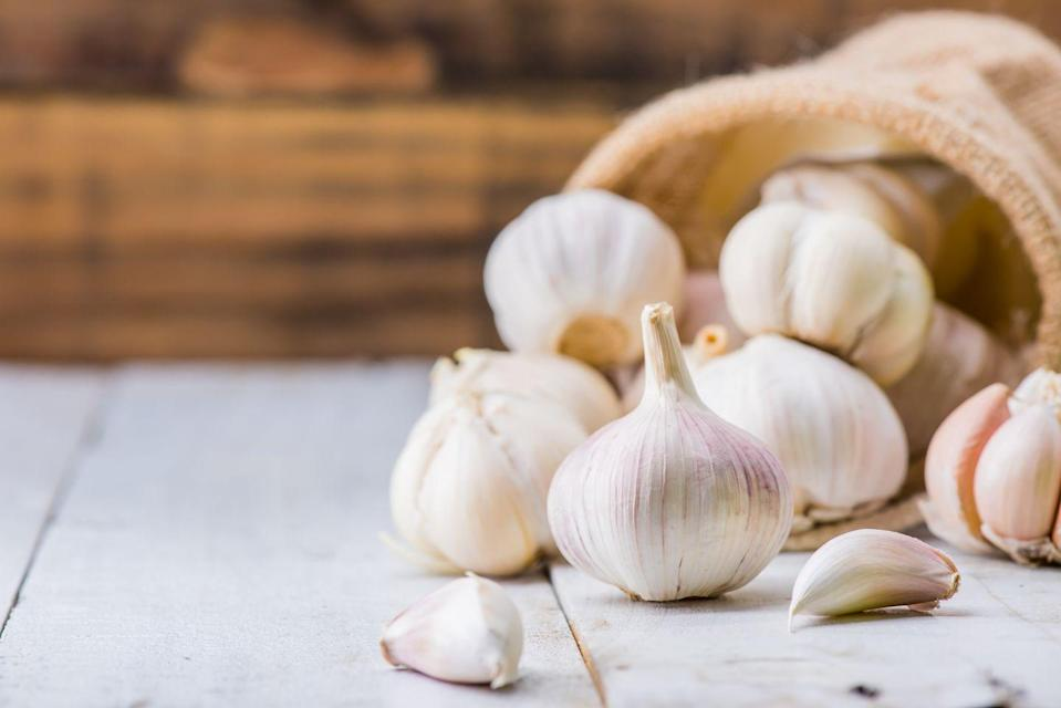 """<p>Population studies have tied higher garlic consumption to lower cancer rates, particularly when it comes to gastrointestinal cancers, according to <a href=""""https://www.ncbi.nlm.nih.gov/pmc/articles/PMC4366009/"""" rel=""""nofollow noopener"""" target=""""_blank"""" data-ylk=""""slk:one review"""" class=""""link rapid-noclick-resp"""">one review</a>. Garlic contains sulfur compounds that exert antimicrobial activity as well as inhibit cell-damaging carcinogens, the researchers note. To reap the biggest benefits, chop or crush your garlic and let it sit for 10 minutes before adding it to your cooking. The brief rest helps the garlic produce more sulfur compounds, <a href=""""https://www.aicr.org/cancer-prevention/food-facts/garlic/"""" rel=""""nofollow noopener"""" target=""""_blank"""" data-ylk=""""slk:the AICR"""" class=""""link rapid-noclick-resp"""">the AICR</a> points out.</p><p><strong>Try it:</strong> <a href=""""https://www.prevention.com/food-nutrition/recipes/a20520320/creamy-roasted-garlic-soup/"""" rel=""""nofollow noopener"""" target=""""_blank"""" data-ylk=""""slk:Creamy Roasted Garlic Soup"""" class=""""link rapid-noclick-resp"""">Creamy Roasted Garlic Soup</a></p>"""