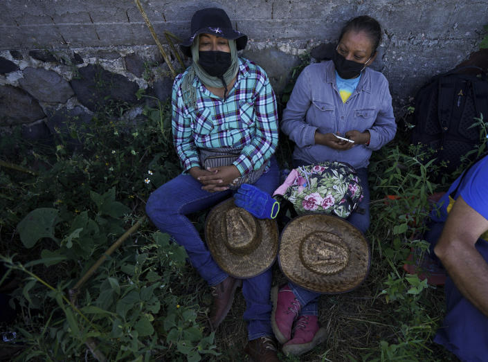 Relatives of missing people take a break during the sixth National Search Brigade for disappeared people on the outskirts of Cuautla, Mexico, Tuesday, Oct. 12, 2021. The government's registry of Mexico's missing has grown more than 20% in the past year and now approaches 100,000. (AP Photo/Fernando Llano)