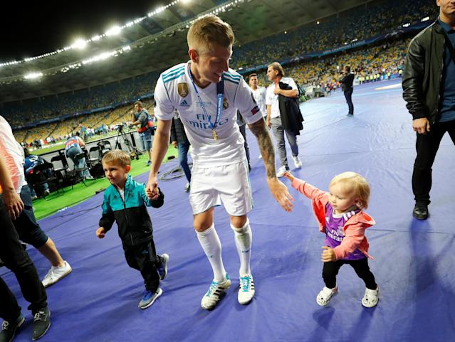 Soccer Football - Champions League Final - Real Madrid v Liverpool - NSC Olympic Stadium, Kiev, Ukraine - May 26, 2018 Real Madrid's Toni Kroos celebrates with family after winning the Champions League REUTERS/Kai Pfaffenbach
