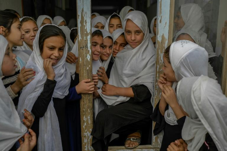 """The Taliban have imposed an extreme interpretation of sharia law during their last period of rule and this time round have said progress in women's rights will be respected """"within the framework of Islamic law"""" (AFP/BULENT KILIC)"""