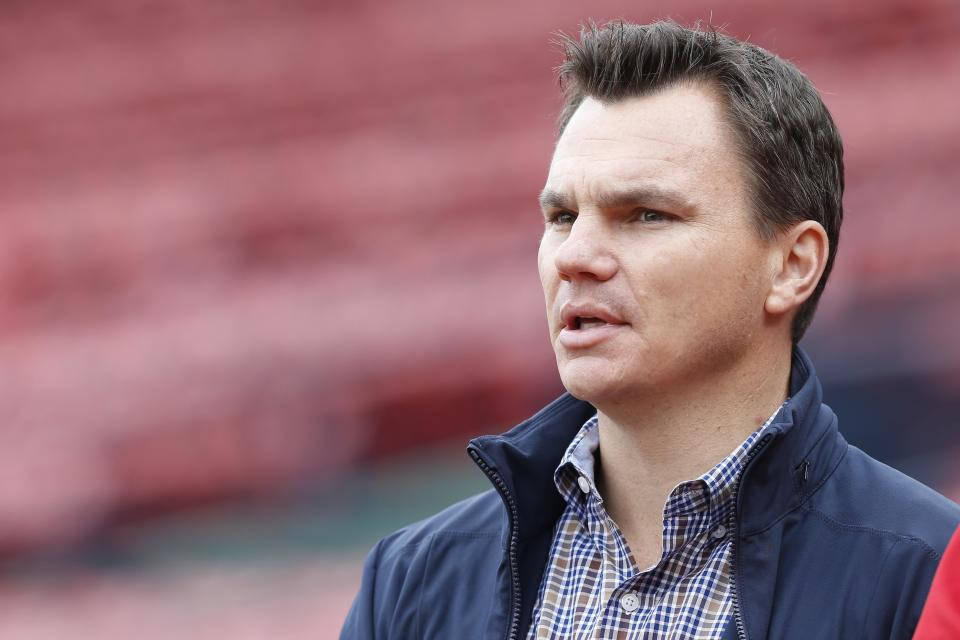 Oct 10, 2013; Boston, MA, USA; Boston Red Sox general manager Ben Cherington watches the team during a workout  in preparation for the American League Championship Series at Fenway Park. Mandatory Credit: Greg M. Cooper-USA TODAY Sports