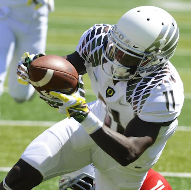 Oregon's Bralon Addison (11) scores against Nicholls State during the first half of an NCAA college football game in Eugene, Ore., Saturday, Aug. 31, 2013. (AP Photo/Greg Wahl-Stephens)