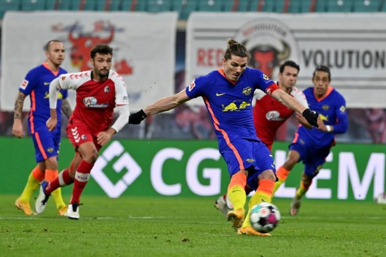 Marcel Sabitzer converts the penalty which sealed RB Leipzig's 2-0 home win over Freiburg on Saturday