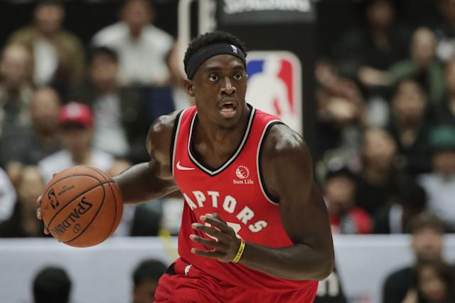 Toronto Raptors' Pascal Siakam dribbles the ball during the first half of an NBA preseason basketball game against the Houston Rockets Tuesday, Oct. 8, 2019, in Saitama, near Tokyo. (AP Photo/Jae C. Hong)