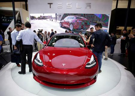 FILE PHOTO: A Tesla Model 3 car is displayed during a media preview at the Auto China 2018 motor show in Beijing