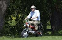 <p>File this under things we never thought we'd see: Prince Philip riding a mini motorcycle. Nonetheless, the Prince enjoyed a ride on a sunny day in Windsor in 2002.</p>