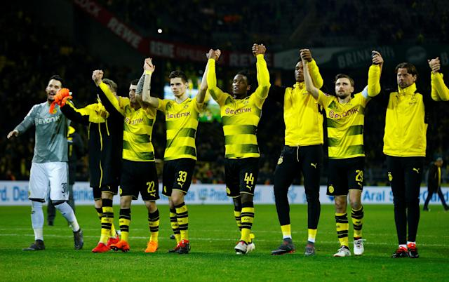 Soccer Football - Bundesliga - Borussia Dortmund vs Eintracht Frankfurt - Signal Iduna Park, Dortmund, Germany - March 11, 2018 Borussia Dortmund players celebrate after the match REUTERS/Thilo Schmuelgen DFL RULES TO LIMIT THE ONLINE USAGE DURING MATCH TIME TO 15 PICTURES PER GAME. IMAGE SEQUENCES TO SIMULATE VIDEO IS NOT ALLOWED AT ANY TIME. FOR FURTHER QUERIES PLEASE CONTACT DFL DIRECTLY AT + 49 69 650050