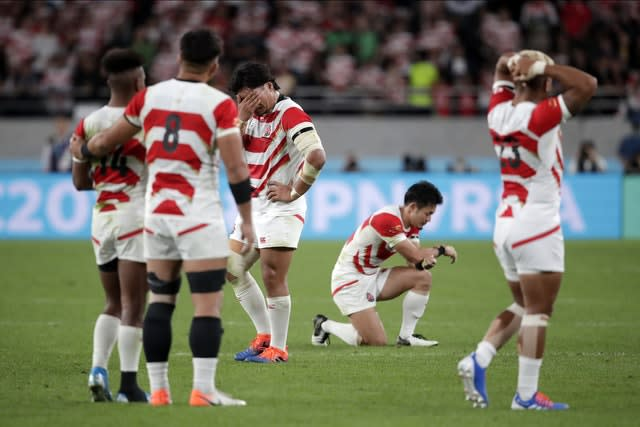 Hosts Japan were knocked out of the World Cup after defeat to South Africa (Jae C Hong/AP)