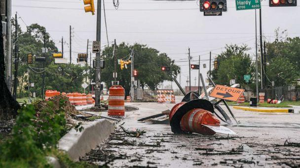 PHOTO: Debris and damaged road construction are left after Tropical Storm Nicholas moved through the area, Sept. 14, 2021 in Houston. (Brandon Bell/Getty Images)