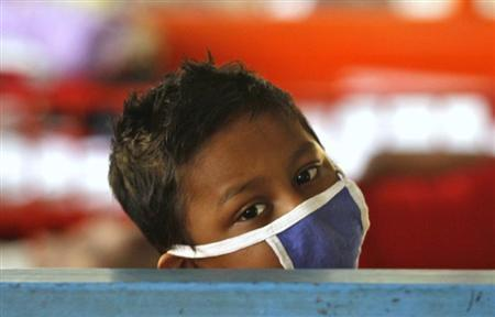 A boy who is a cancer patient rests inside the children's ward at the Cancer Centre Welfare Home and Research Institute in Kolkata March 16, 2012. REUTERS/Rupak De Chowdhuri