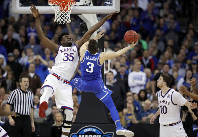 Duke's Grayson Allen (3) is unable to score past Kansas' Udoka Azubuike as Kansas' Sviatoslav Mykhailiuk watches during the second half of a regional final game in the NCAA men's college basketball tournament Sunday, March 25, 2018, in Omaha, Neb. (AP Photo/Charlie Neibergall)