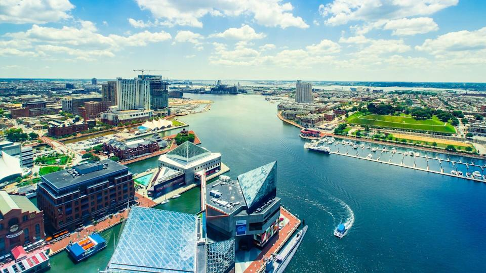 Aerial view of the Inner Harbor of Baltimore, Maryland on a clear summer day.