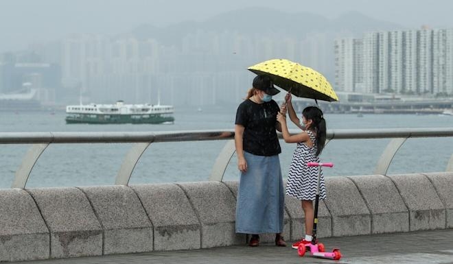 A mother and daughter stop for a moment in Tamar Park in Admiralty. Photo: Edmond So