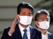 Japan's Prime Minister Shinzo Abe wearing a protective face mask arrives at his official residence, amid the coronavirus disease (COVID-19) outbreak, in Tokyo