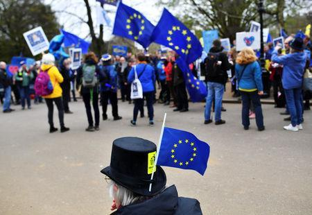 EU supporters, calling on the government to give Britons a vote on the final Brexit deal, participate in the 'People's Vote' march in central London, Britain March 23, 2019. REUTERS/Dylan Martinez