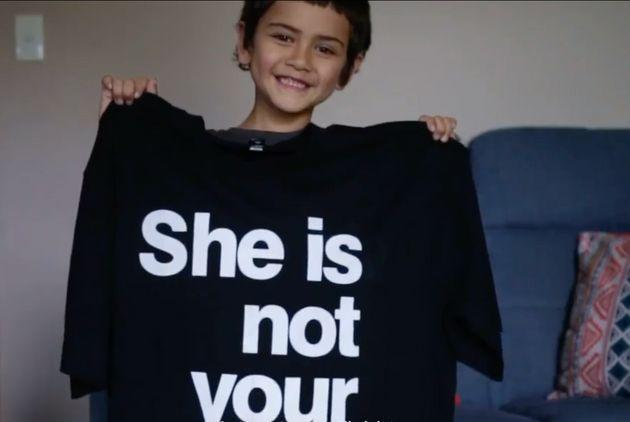 Angelou Brown holds up an XXXL 'She Is Not Your Rehab' T-shirt for