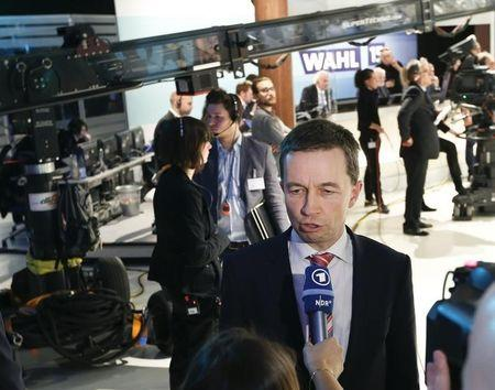 "Lucke, chairman of eurosceptic German party ""Alternative fuer Deutschland"" or Alternative for Germany (AfD) speaks during an interview after the first exit polls in a state election in Hamburg"