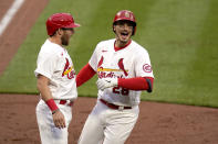 St. Louis Cardinals' Nolan Arenado, right, is congratulated by teammate Austin Dean after hitting a two-run home run during the eighth inning of a baseball game against the Milwaukee Brewers Thursday, April 8, 2021, in St. Louis. (AP Photo/Jeff Roberson)