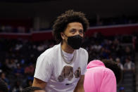Detroit Pistons guard Cade Cunningham watches from the sideline during the first half of a preseason NBA basketball game against the San Antonio Spurs, Wednesday, Oct. 6, 2021, in Detroit. (AP Photo/Carlos Osorio)