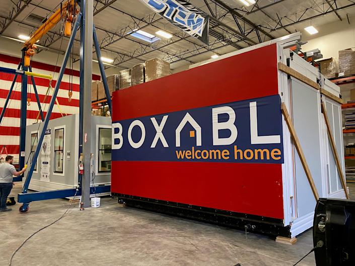 the Boxabl logo in a manfucaturing space